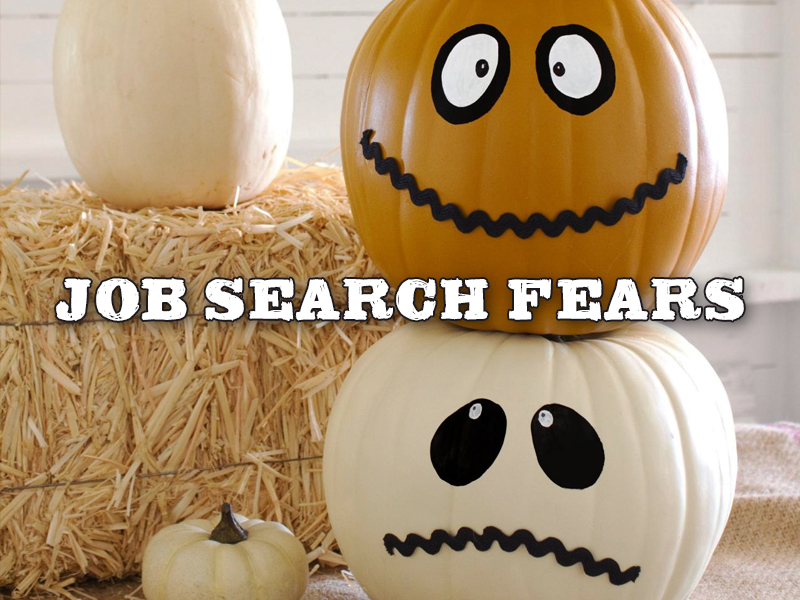 Halloween pumpkins and a stack of hay with the job search fears sign