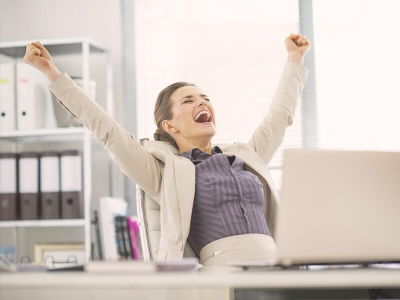Job seeker happily raising hands